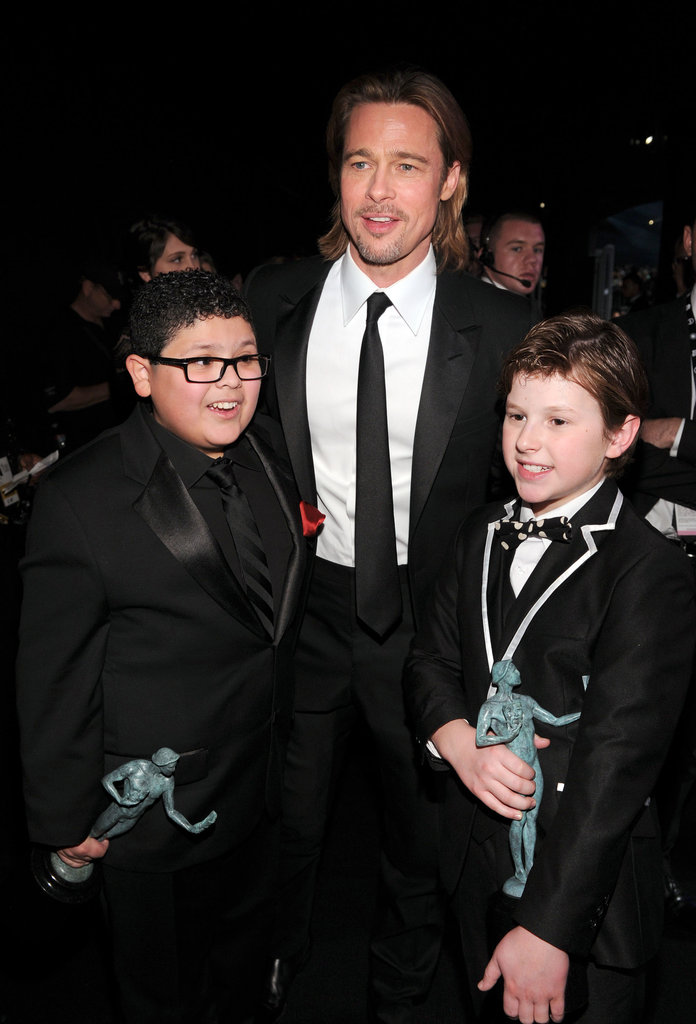 Brad Pitt posed with Modern Family's young stars.