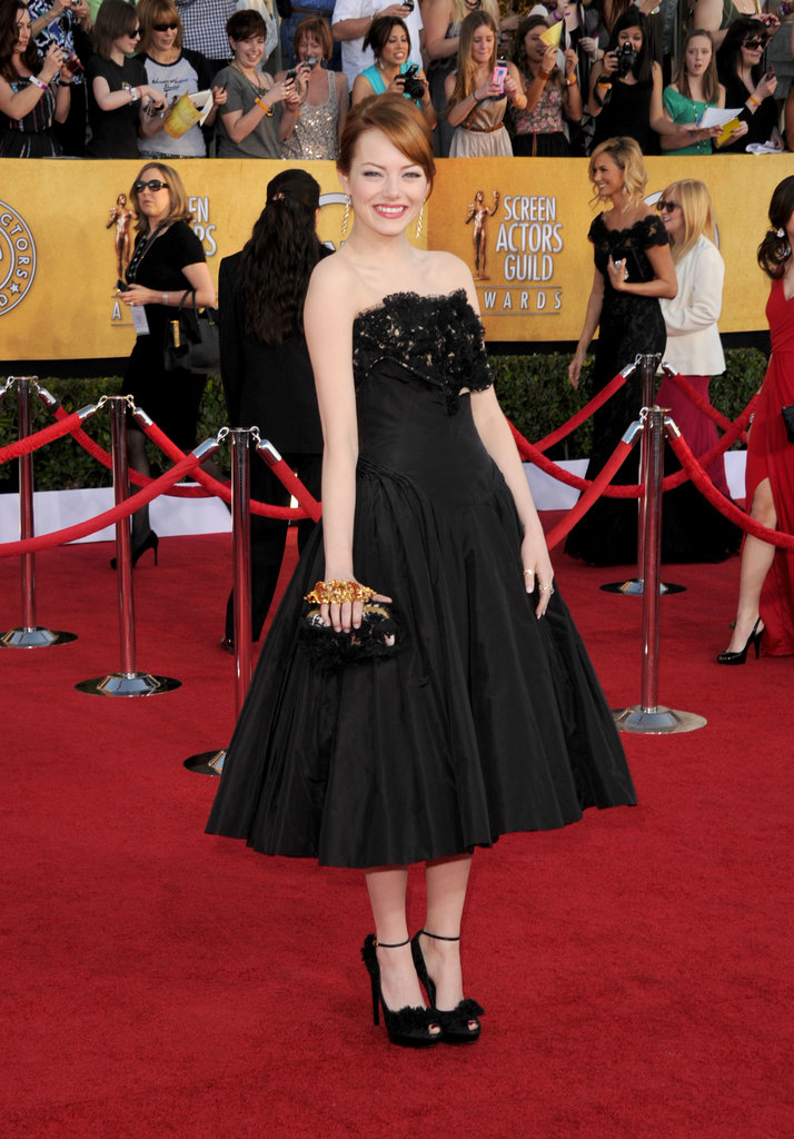 Emma Stone smiled in Alexander McQueen.