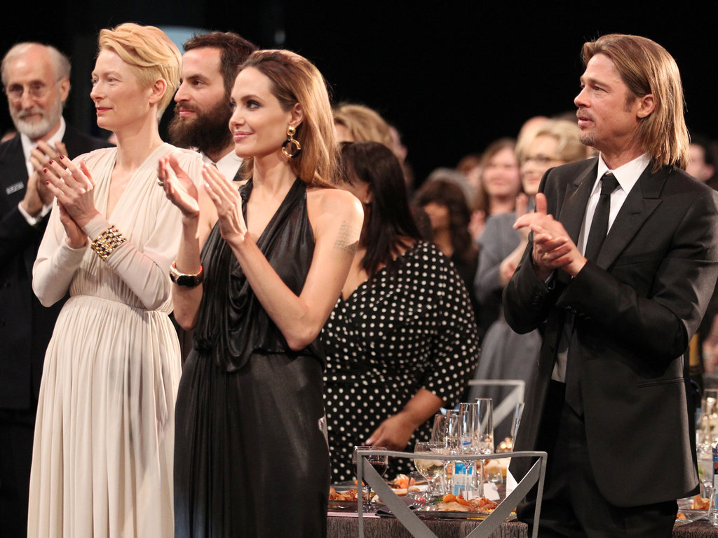 Brad Pitt and Angelina Jolie shared a table with Tilda Swinton.