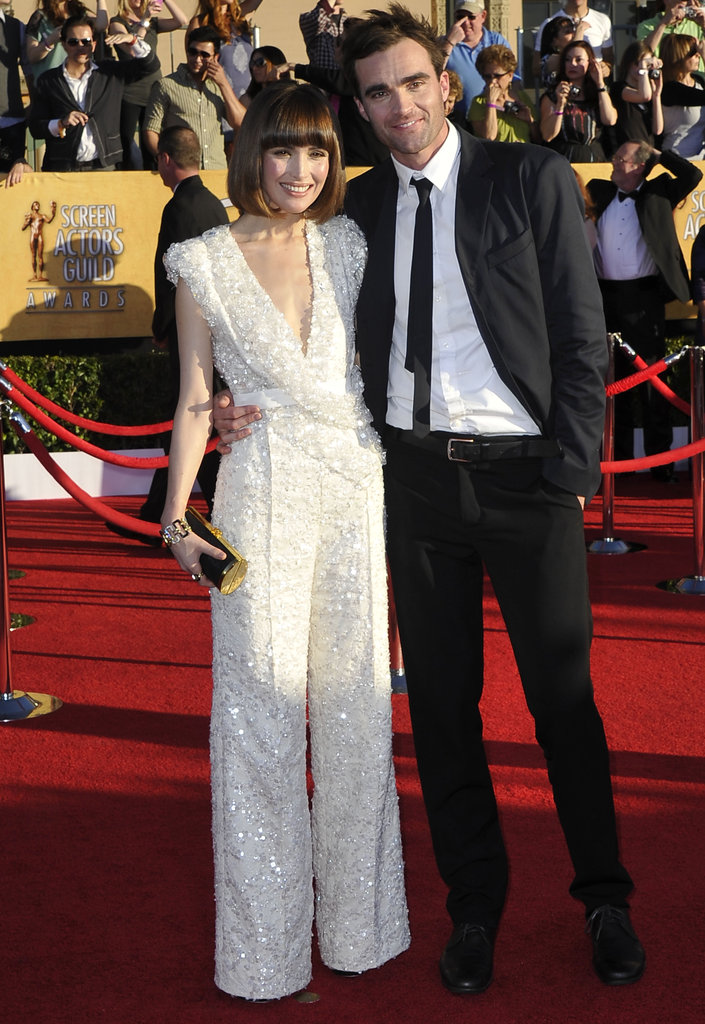 Rose Byrne and her date pose on the red carpet.