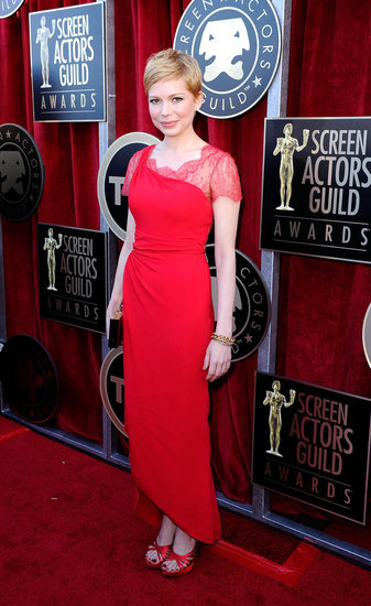 Michelle Williams Opts For Red Lace in a Valentino Gown at the SAG Awards