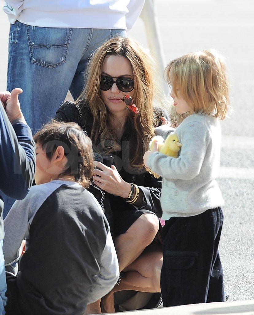 Angelina Jolie sat with Pax and Knox Jolie-Pitt.