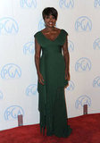 Viola Davis stepped out in a dark emerald creation by Hervé L. Leroux — we love the draped asymmetrical hem as an unexpected twist to this elegant floor-length gown.