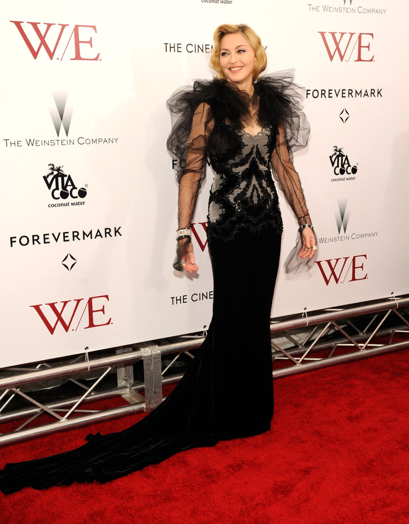 Madonna showed off the long train on her Marchesa dress at the W.E. premiere.