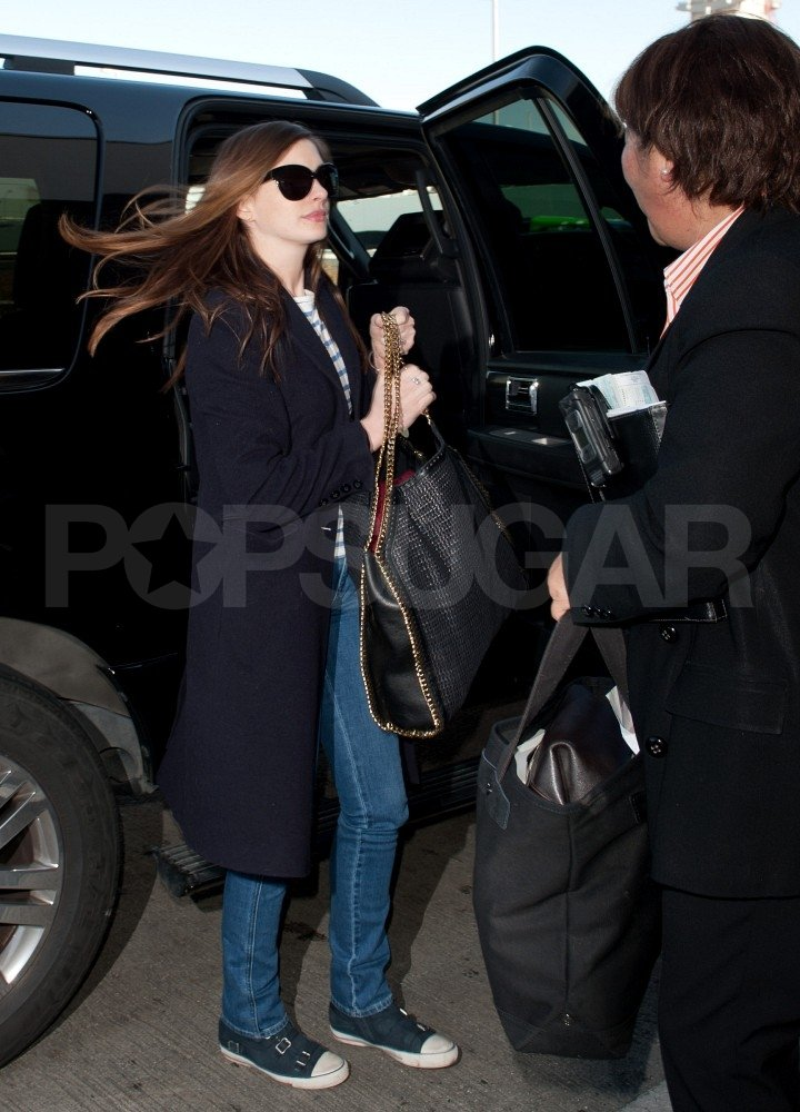 Anne Hathaway stepped out of her car at LAX.