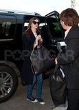Anne Hathaway had big sunglasses on at LAX.