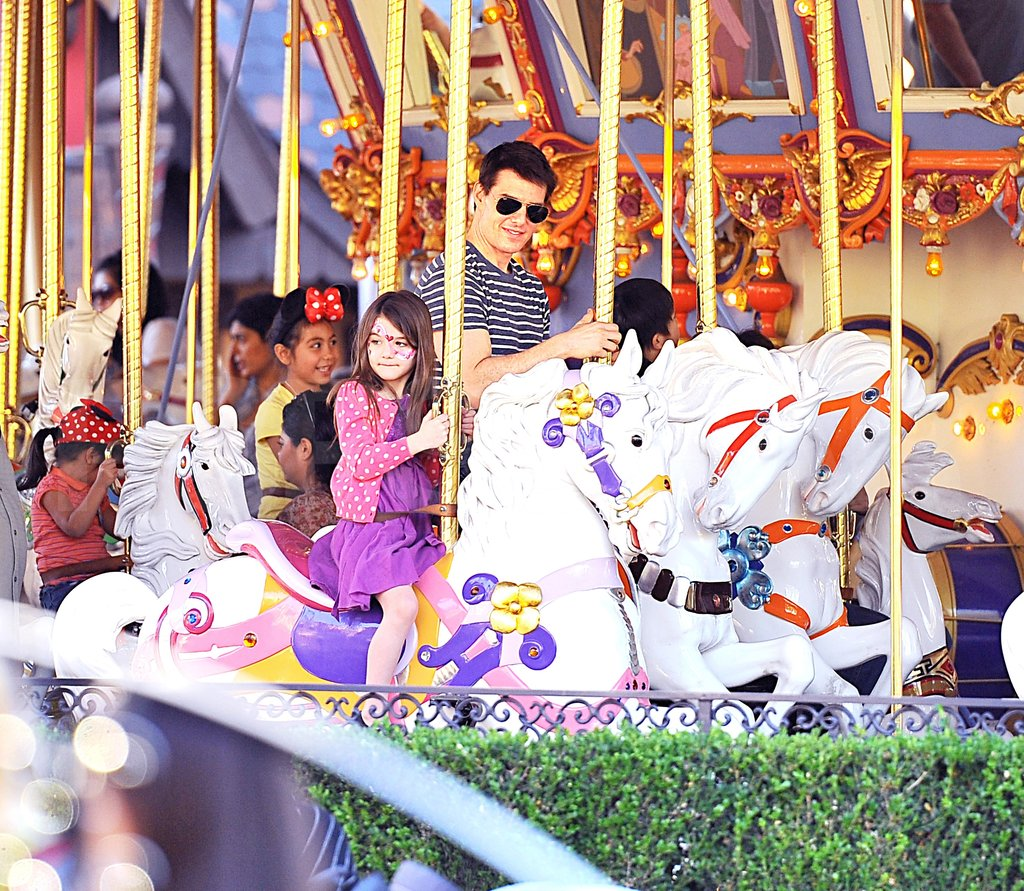 Tom Cruise and Suri Cruise rode a carousel.