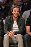 Something made David Beckham laugh during the basketball game.