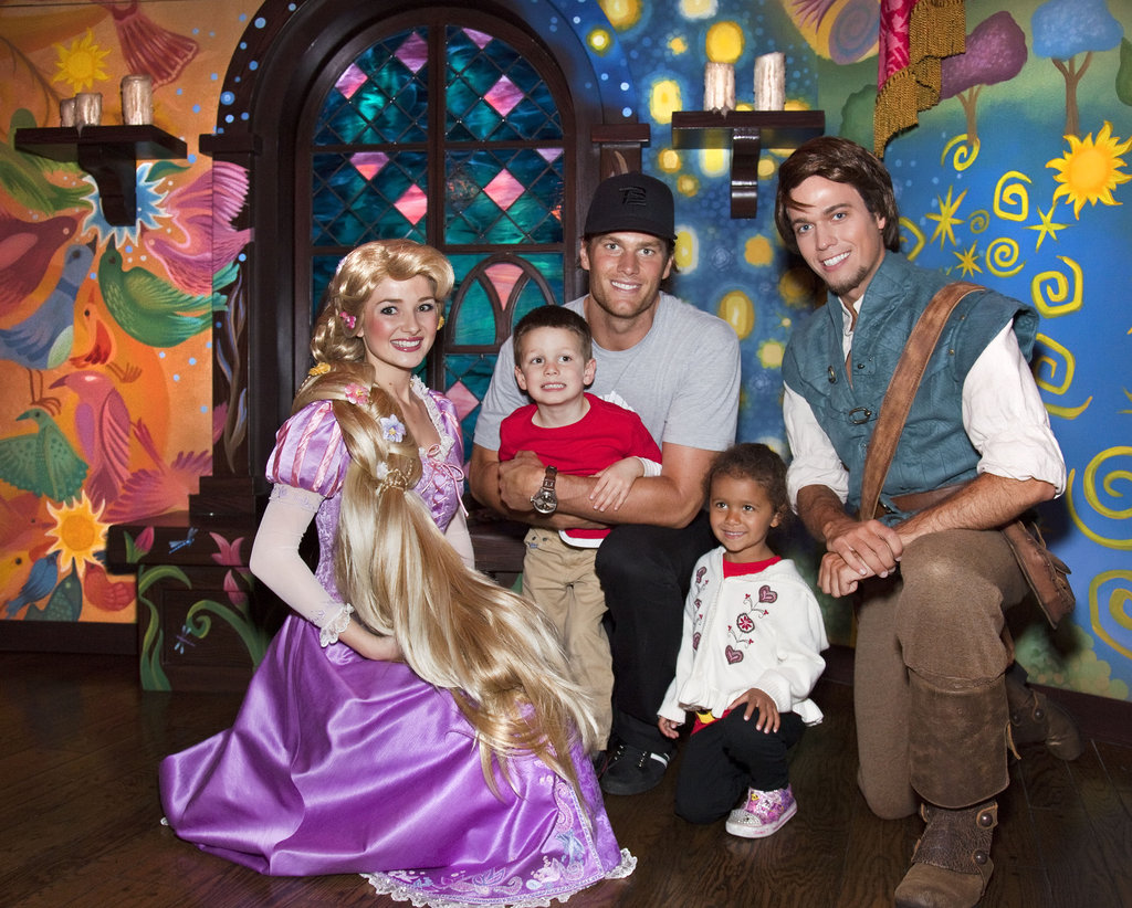 Tom Brady took his eldest son, Jack, to pose with Disney characters in April 2011.