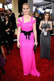 The Hunger Games' Jennifer Lawrence opted for a fucshia number with a black bow tie belt in 2011.