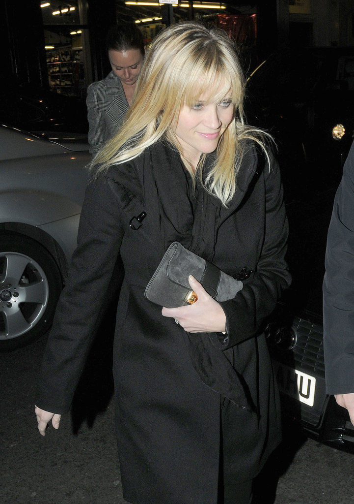 Reese Witherspoon wore a black coat out in London.