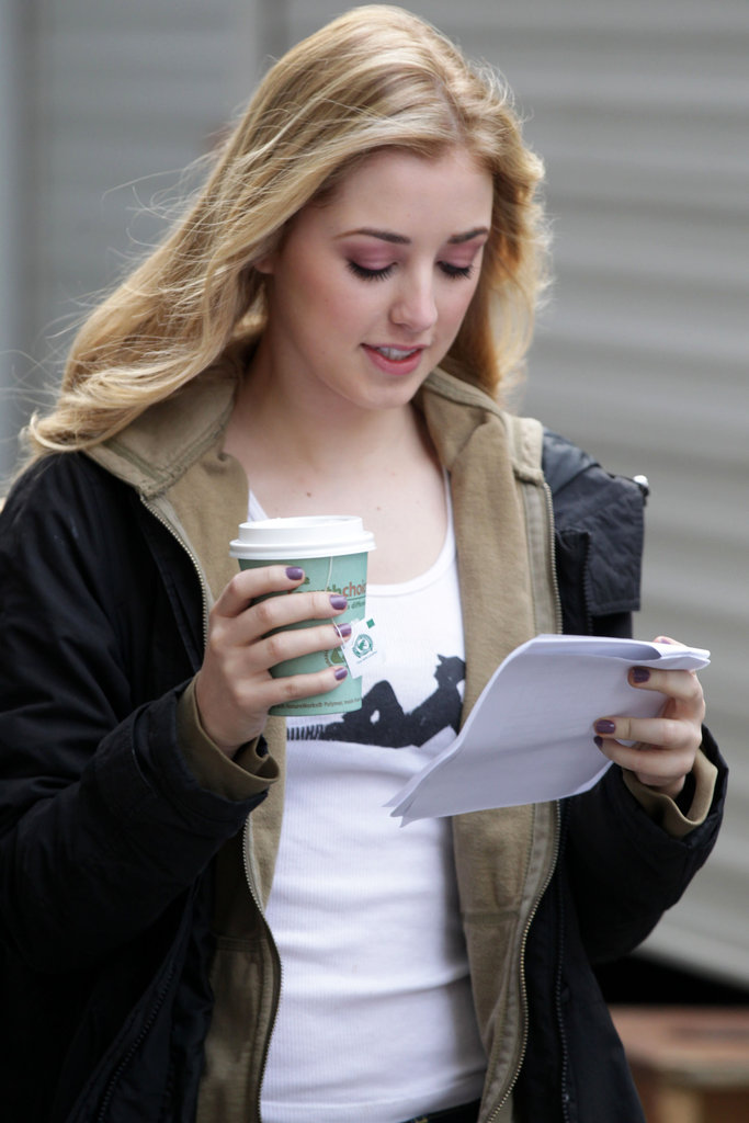 Ella Rae Peck studied her lines on the way to set.