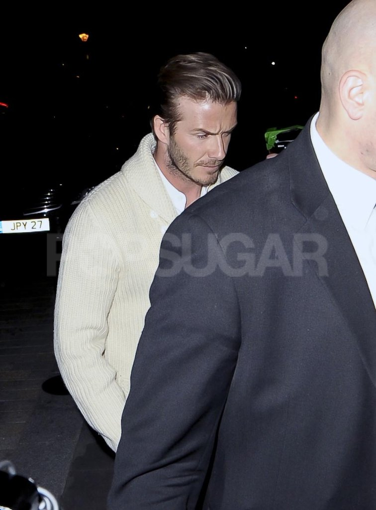 David Beckham in a white sweater.