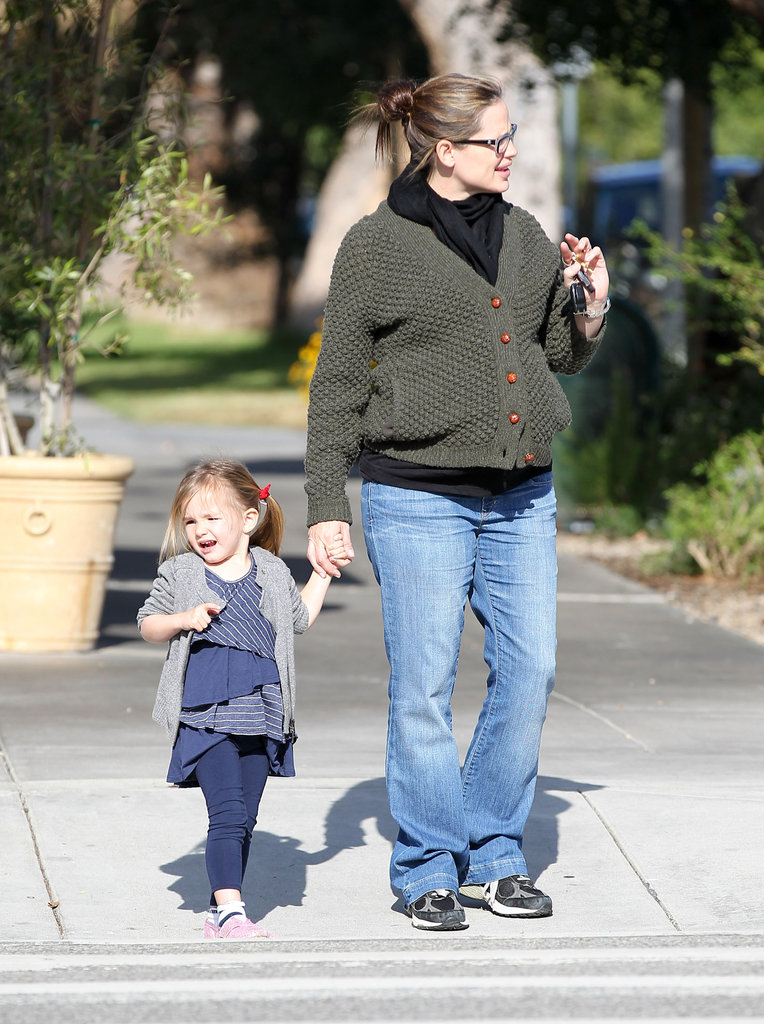 Jen and Seraphina looked both ways before crossing the street.