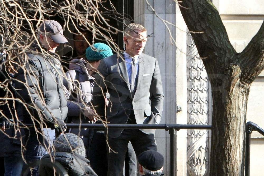 Daniel Craig in a suit on set.