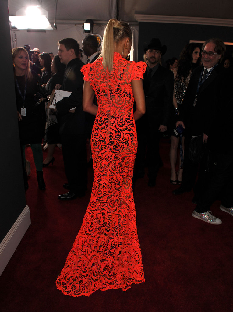 Fergie wore hot orange to the Grammys.
