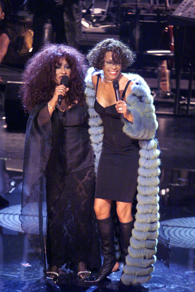 Whitney performs with Chaka Khan in 1999.