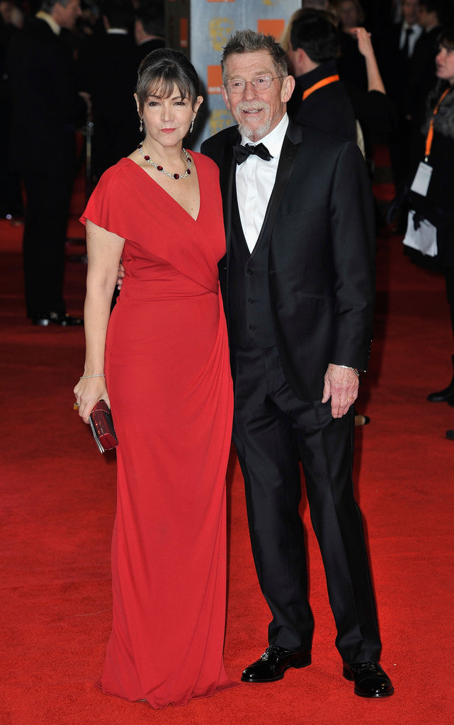 John Hurt and Ann Rees Meyers arrive at the BAFTAs.