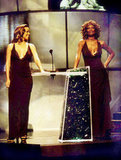 Mariah Carey and Whitney Houston have fun at the 1998 VMAs.
