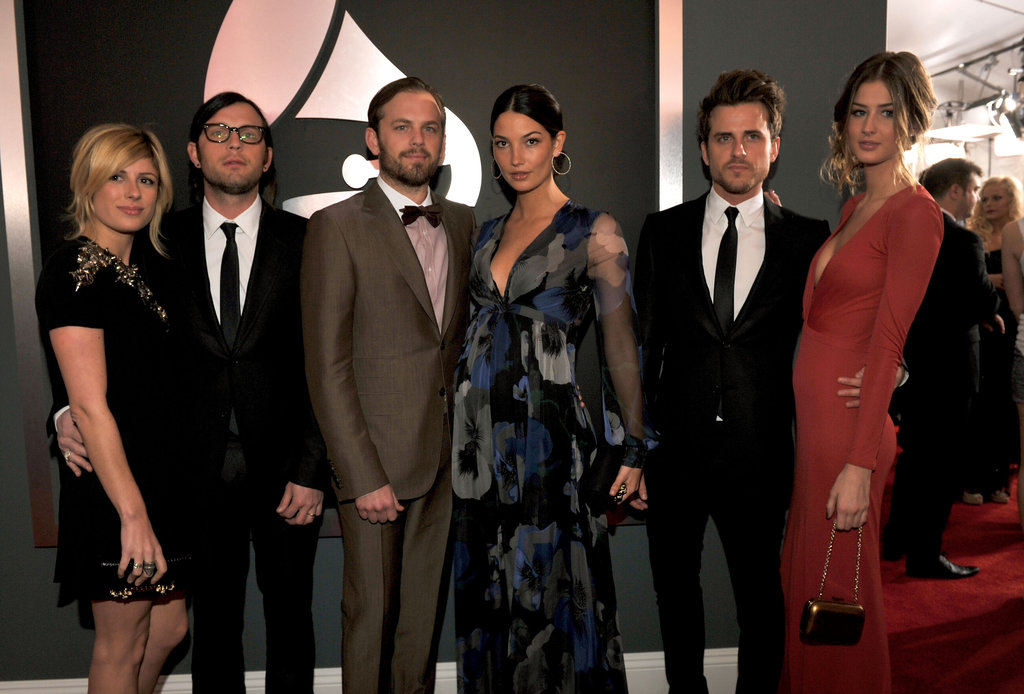 The Kings of Leon and their dates look stylish on the red carpet.