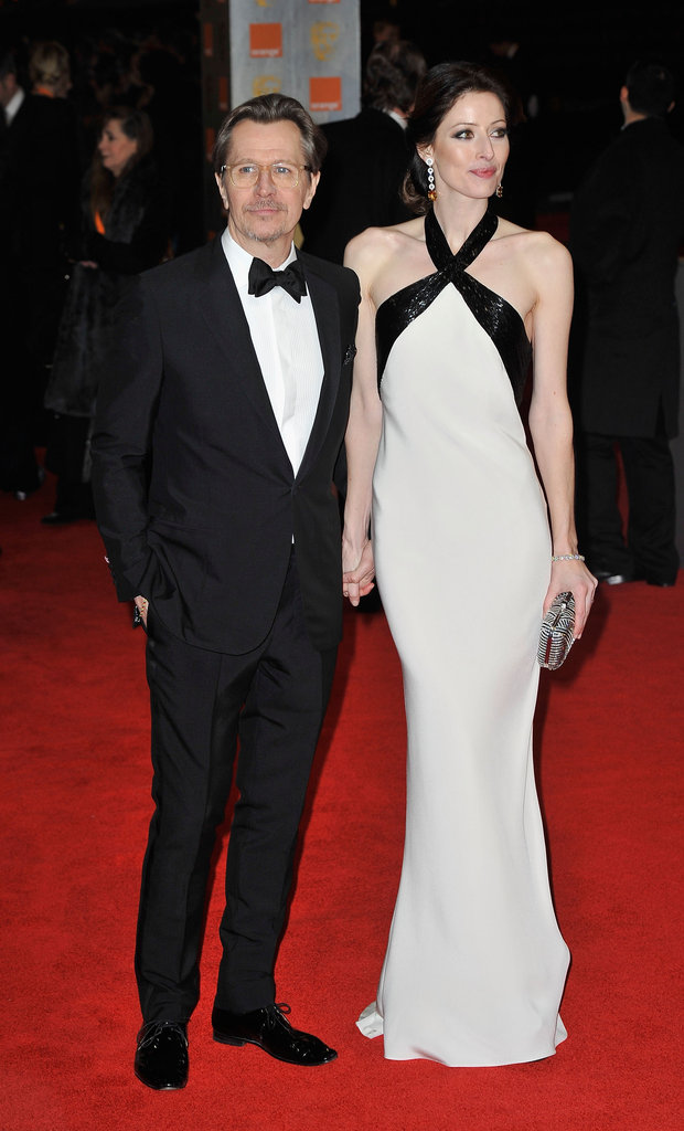 Alexandra Edenborough and Gary Oldman pose on the red carpet.