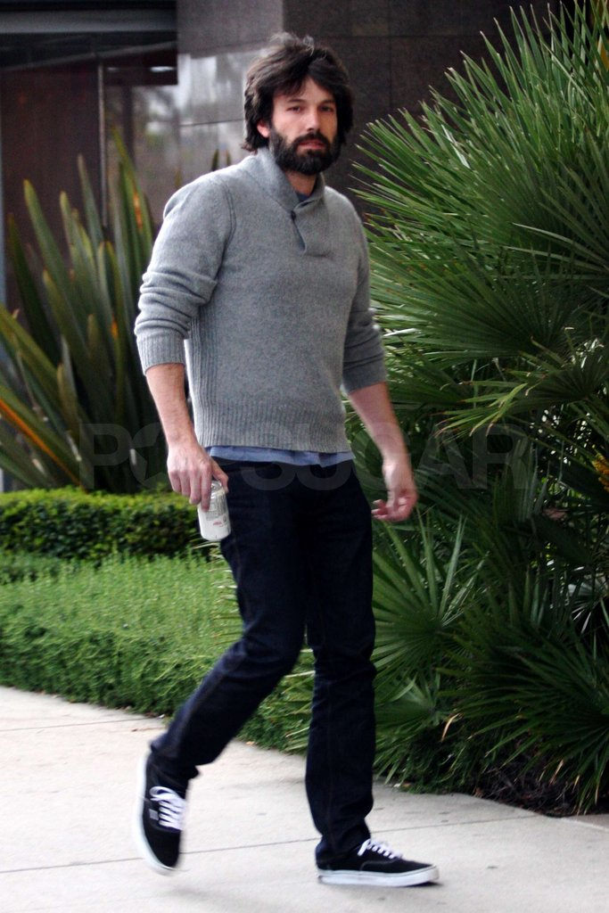 Ben Affleck carried a can of soda.
