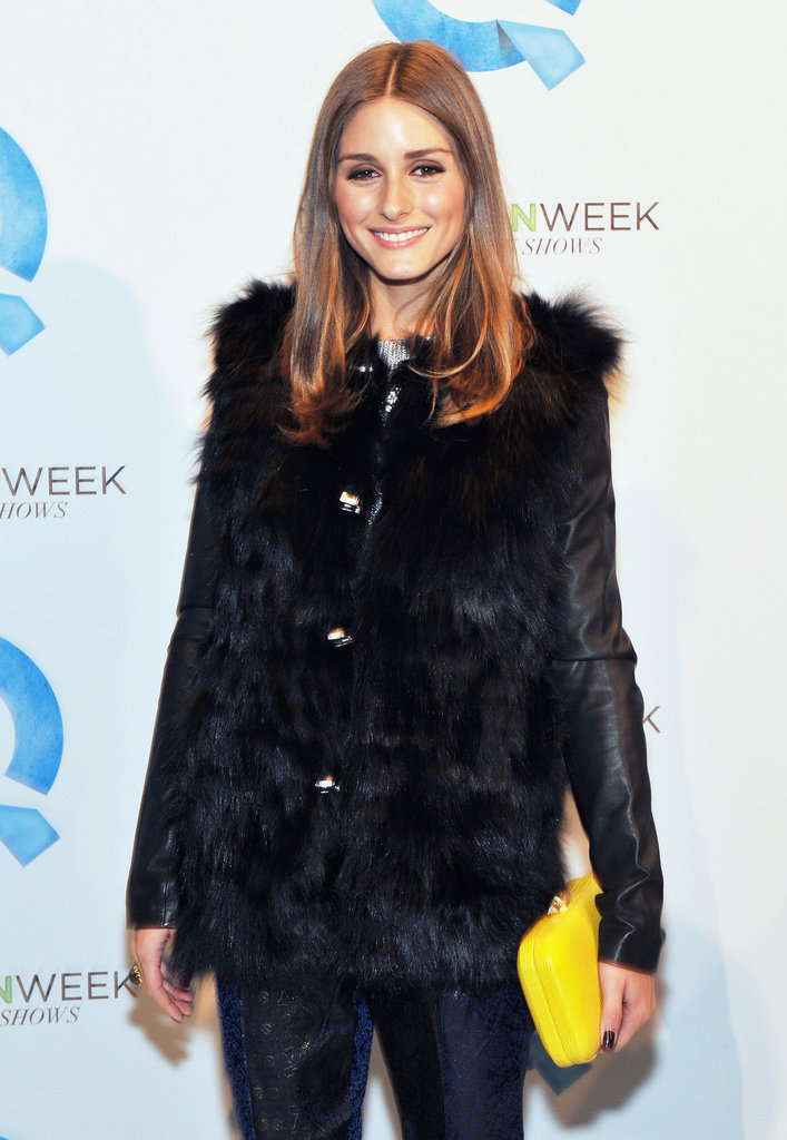 Olivia Palermo with a yellow clutch.