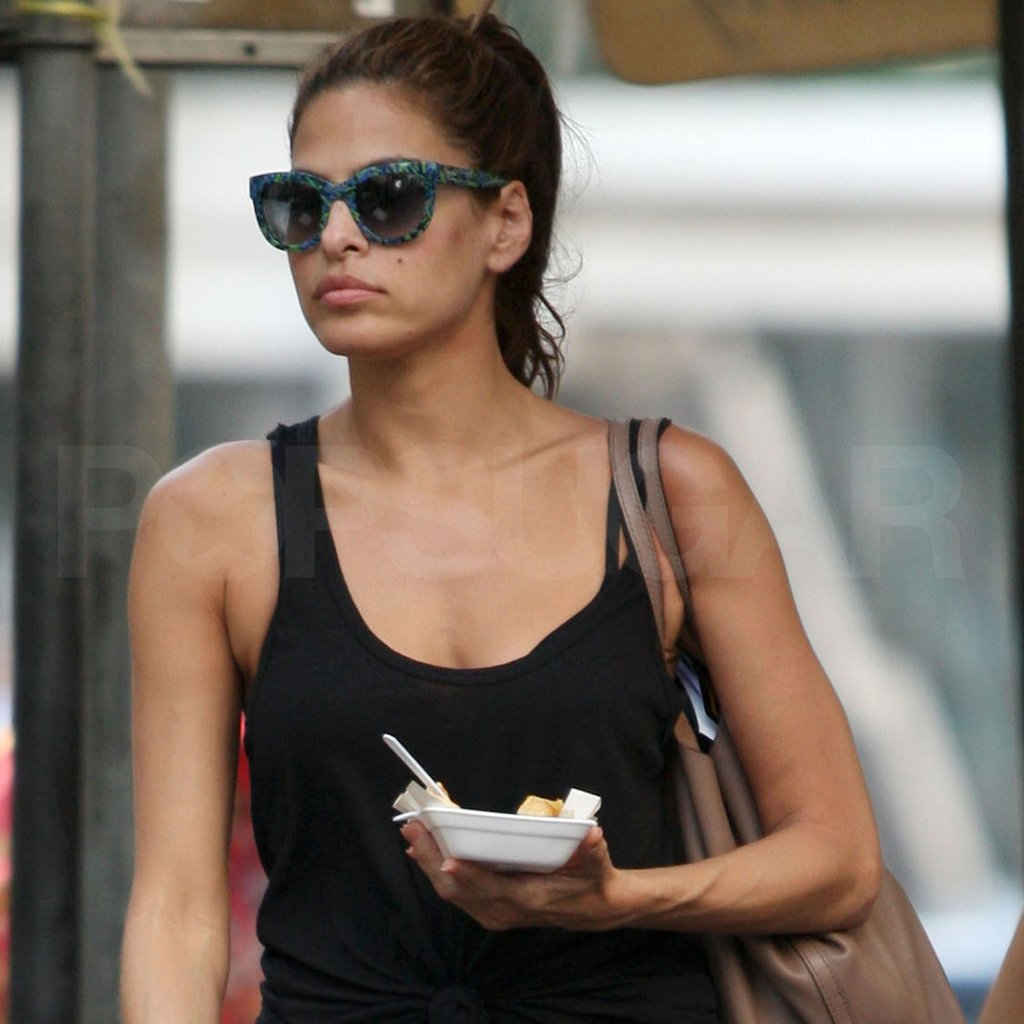 Eva Mendes got a snack while in Thailand visiting Ryan Gosling.  Images courtesy AKM Images/GSI Media