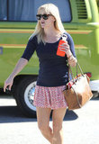 Reese Witherspoon with a water bottle.