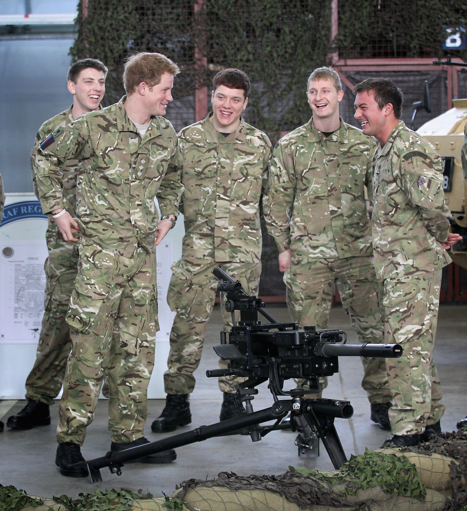 Prince Harry checked out weapons.