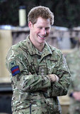 Prince Harry smiled while visiting with fellow servicemen and women.
