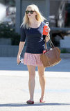 Reese Witherspoon made us long for sunny days in a printed mini and flats.