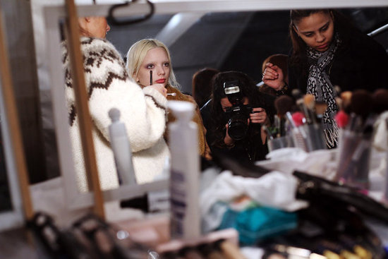 A model sits calmly amongst the buzz backstage. Photo: Roger Kisby