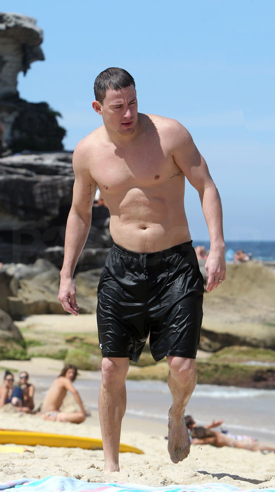 Channing wore black board shorts on the beach.