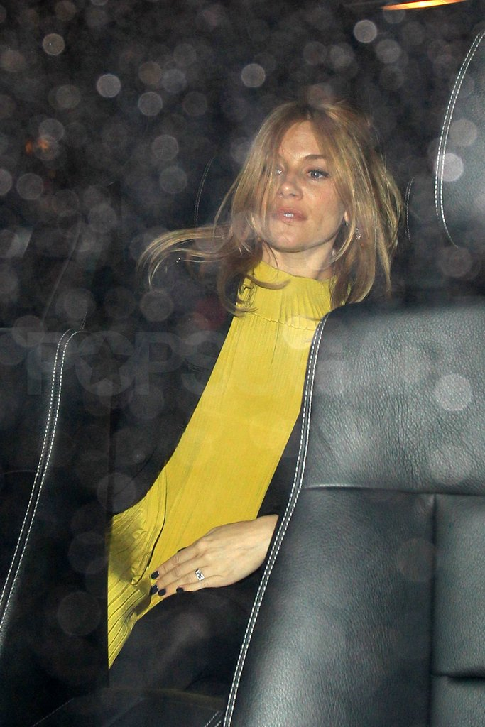 Pregnant Sienna Miller showed a new diamond ring.