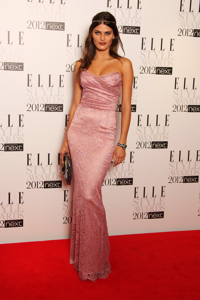 Model Isabeli Fontana flaunted her curves in a soft pink strapless.