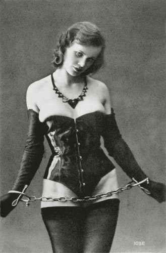 While high-society women were wearing corsets to be fashionable, corsets have long been a big part of fetishism fashion for bondage and S&M. This BDSM look from the '30s isn't much different than what we'd see today.