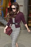 Victoria Beckham wore a plaid dress and purple cardigan.