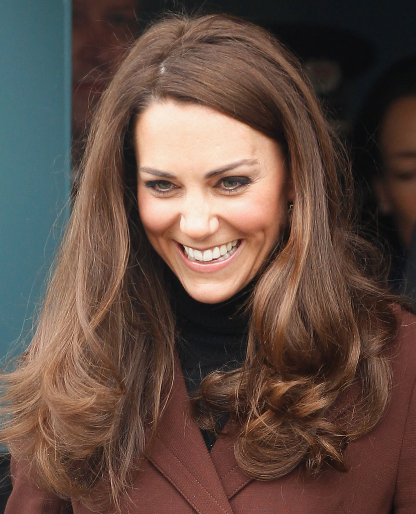 Kate Middleton wore her hair curled.