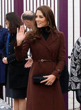 Kate Middleton wore a brown coat from Hobbs.