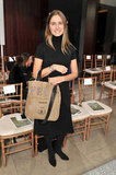 Lauren Bush had her trusty Feed tote at her side front row at Tory Burch.