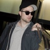 Robert Pattinson wore a black baseball hat.