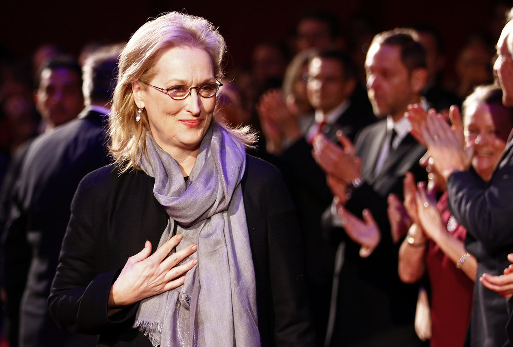 Meryl kept warm in a gray scarf.