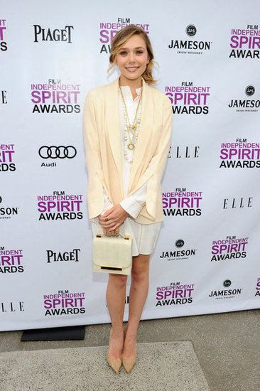 Elizabeth kept it light in a fresh cream and white ensemble at the 2012 Independent Spirit Awards. Her structured bag was right on trend, ladylike cum cool.         Button Front Tops by J. JillPumps by Stuart Weitzman