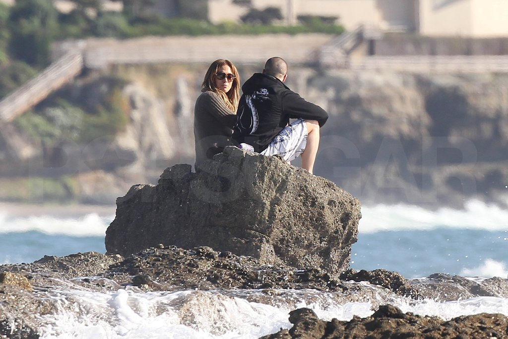 Jennifer Lopez and Casper Smart sat together on a rock.