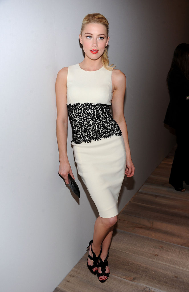Amber Heard posed backstage in a lace sheath dress before the Michael Kors runway show.
