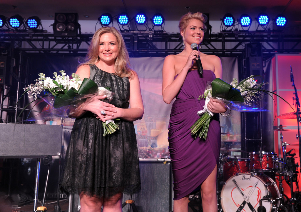 Kate accepted a bouquet of flowers on the stage.