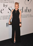 Sienna Miller showed off her growing baby bump in a floor-skimming Boss Black dress and Pamela Love jewelry.