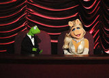 Muppets Kermit the Frog and Miss Piggy sat in the balcony.
