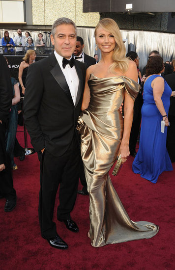 Stacy Keibler sported a gold Marchesa gown while on the arm of George Clooney at the Oscars in February 2012.